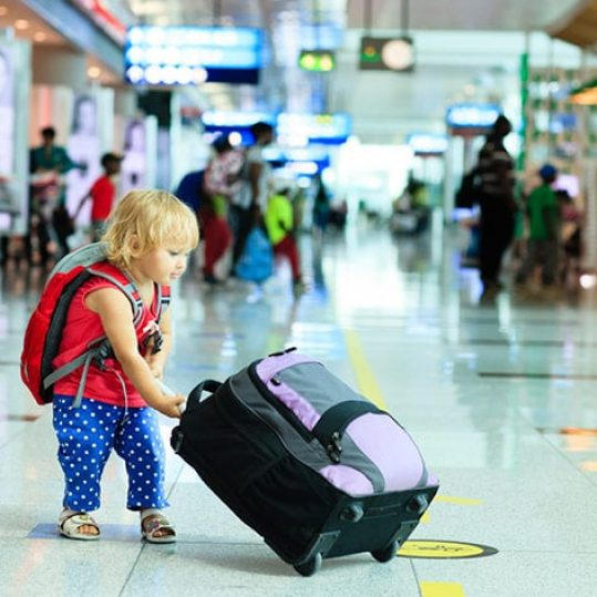 kid needing luggage storage